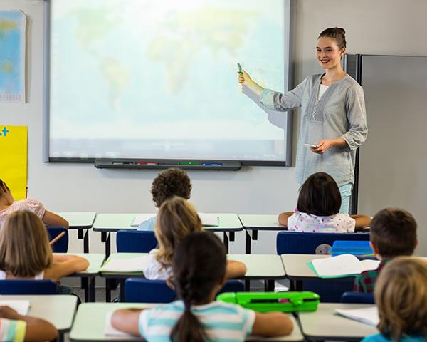 Teacher using interactive digital whiteboarding for classroom