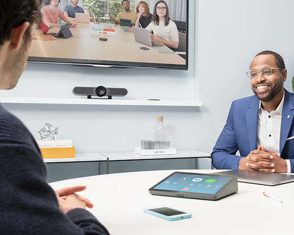Small team of people using video conferencing